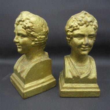 anciens chenets cheminee visages transformes serre livres fonte dore