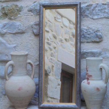 miroir rectangulaire forme allongee bois couleur doree et argentee