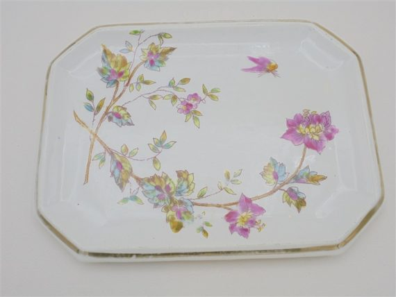 ancien petit plat en ceramique au decor floral colore vide poche
