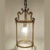 ancien luminaire lanterne de vestibule verre cylindrique decor etoiles taille structure bronze couleur dore patine